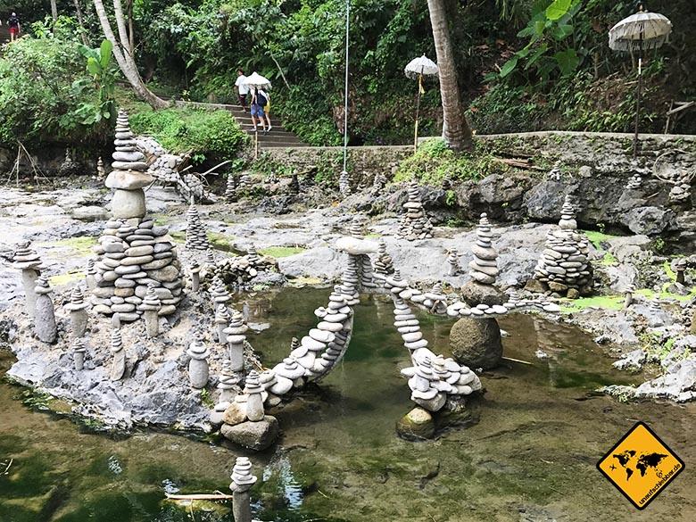Stein Skulpturen Blangsinga Waterfall